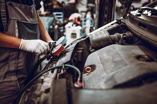 Mechanic testing temperature of car